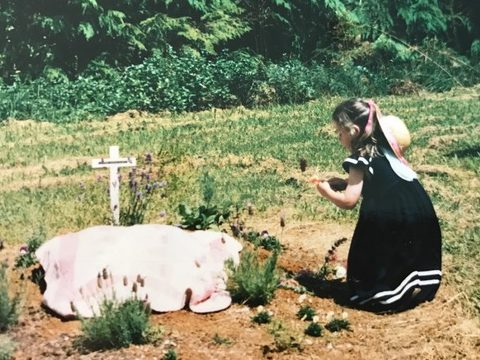 Four-year-old Sian at her father's grave.
